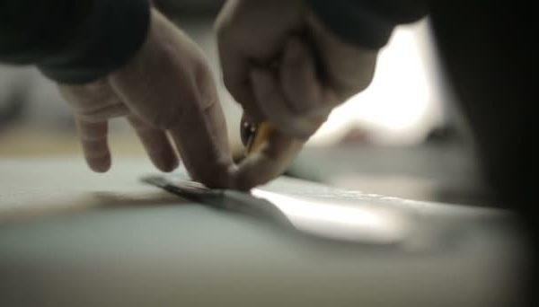 depositphotos_63778307-stock-video-production-of-handbags-man-cuts